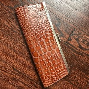 Maroon and tan clutch with reptile embossing
